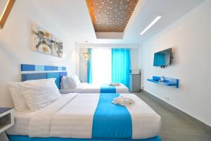 A bed or beds in a room at One Azul Boracay