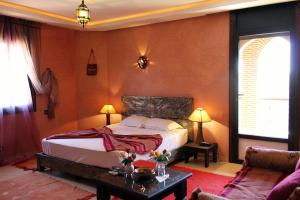 A bed or beds in a room at Palais Dar Ouladna
