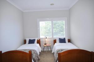 A bed or beds in a room at WATERVIEW ESTATE - AMAZING OCEAN VIEWS