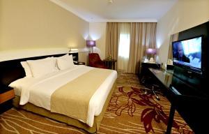 Кровать или кровати в номере Excelsior Hotel Downtown