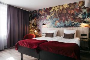 A bed or beds in a room at Best Western Kom Hotel Stockholm