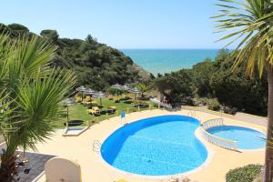 A view of the pool at Rocha Brava Village Resort or nearby