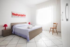 Letto o letti in una camera di Villa Trinacria Apartments