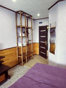 Кровать или кровати в номере Отель Георгиевский