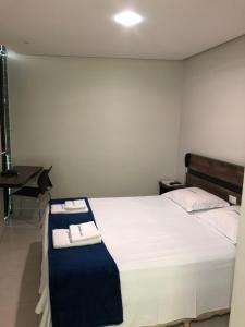 A bed or beds in a room at POUSADA CAJÁ