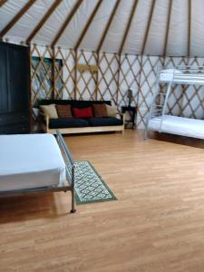 A bed or beds in a room at Pine Mountain RV Resort
