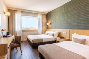 Cama ou camas em um quarto em HF Ipanema Porto