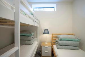 A bunk bed or bunk beds in a room at WeMeet@Melbourne Center