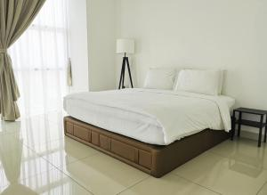 A bed or beds in a room at KSL Hotel and Resort - Apartment
