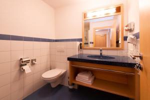 Ein Badezimmer in der Unterkunft Hotel Bergkranz