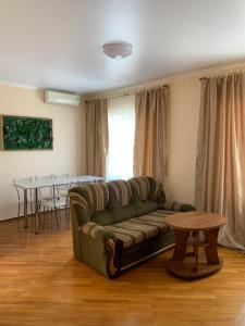 A seating area at Гостевой дом GOLD