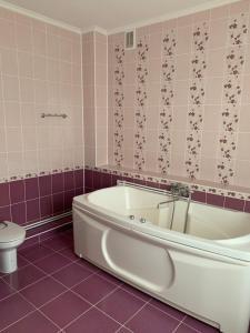 A bathroom at Гостевой дом GOLD