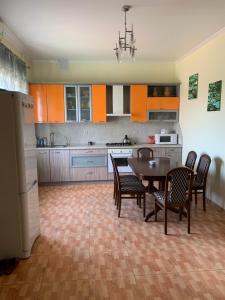 A kitchen or kitchenette at Гостевой дом GOLD
