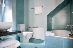 A bathroom at SEA FRONT FISCARDO ROOMS