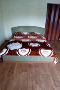 Кровать или кровати в номере Apartment on Leninskiy 27
