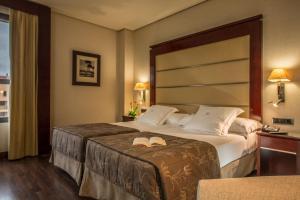 Ein Bett oder Betten in einem Zimmer der Unterkunft Hotel Valencia Center