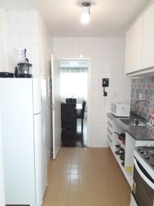 A kitchen or kitchenette at Apartamento Ondina