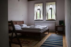 A bed or beds in a room at Mutafova Guest House