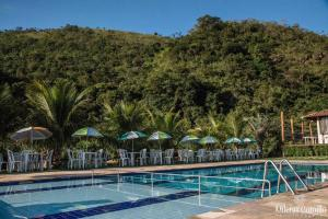 The swimming pool at or near Pousada Cachoeira do Lobo