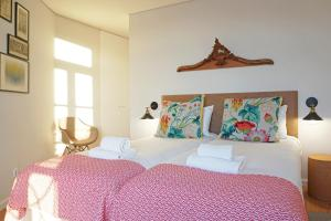 A bed or beds in a room at Porto View by Patio 25