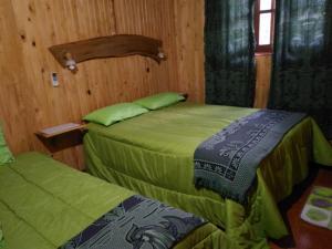 Una cama o camas en una habitación de Mocona Guazu