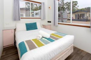 A bed or beds in a room at Torquay Holiday Park