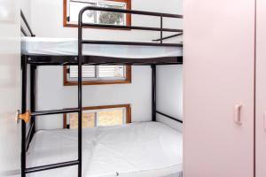 A bunk bed or bunk beds in a room at Torquay Holiday Park