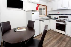 A kitchen or kitchenette at Torquay Holiday Park