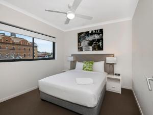 A bed or beds in a room at Atrio Apartments