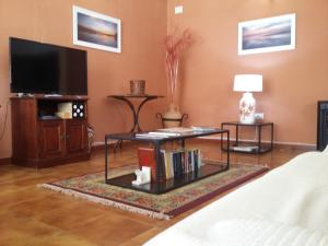 A television and/or entertainment center at Hotel Tres Jotas Conil
