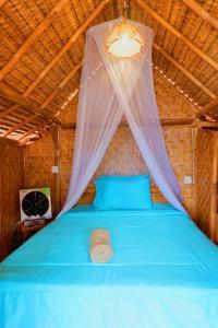 Postel nebo postele na pokoji v ubytování Tropical Garden Inn