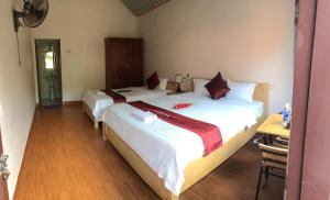 A bed or beds in a room at Tam Coc Westlake Homestay
