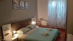 Cama o camas de una habitación en Rooms Šećer