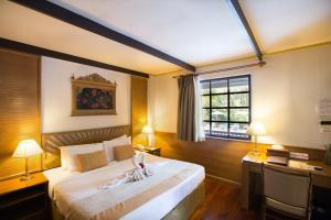 A bed or beds in a room at The Imperial Mae Hong Son Resort