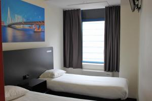 A bed or beds in a room at easyHotel Rotterdam City Centre