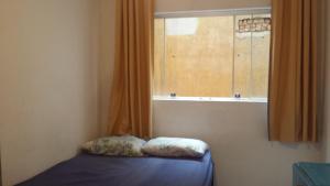 A bed or beds in a room at Apartamento Centro Histórico