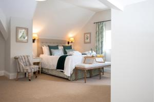 A bed or beds in a room at The Farmhouse at Bodnant Welsh Food