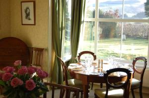 A restaurant or other place to eat at The Old Vicarage Dolfor