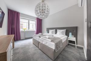 Łóżko lub łóżka w pokoju w obiekcie PlayRoom Aparthotel
