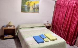 Una cama o camas en una habitación de El Pasaje