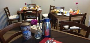 Ein Restaurant oder anderes Speiselokal in der Unterkunft Pension STELLA