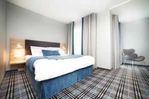 Łóżko lub łóżka w pokoju w obiekcie Villa Familia