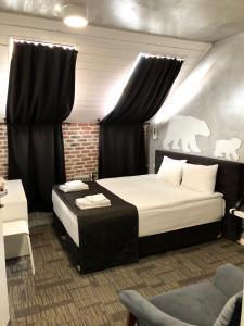 Кровать или кровати в номере Ред Брик Китай Город