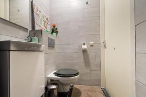 A bathroom at Arena Suite