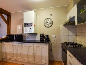 A kitchen or kitchenette at Historic Holiday Home on Working Farm in Le Moustoir