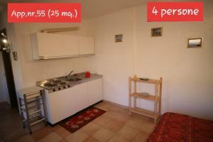 A kitchen or kitchenette at La Tonalina 55