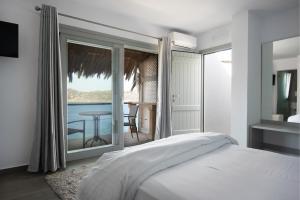מיטה או מיטות בחדר ב-Greco Philia Hotel Boutique Mykonos