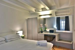 Ein Bett oder Betten in einem Zimmer der Unterkunft Urban Hotel Design