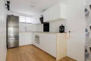 A kitchen or kitchenette at Le Petit Milex