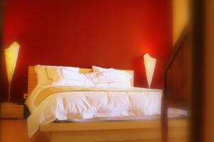 A bed or beds in a room at Les Citronniers d'Azur